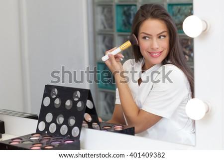 Beautiful woman portrait wearing make up - stock photo