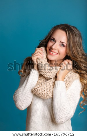 beautiful woman portrait wearing warm clothing. Studio portrait. - stock photo