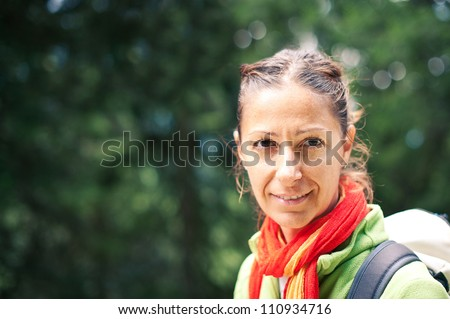 Beautiful woman portrait with backpack outdoors. - stock photo