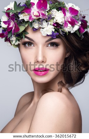 Beautiful woman portrait with flowers on head