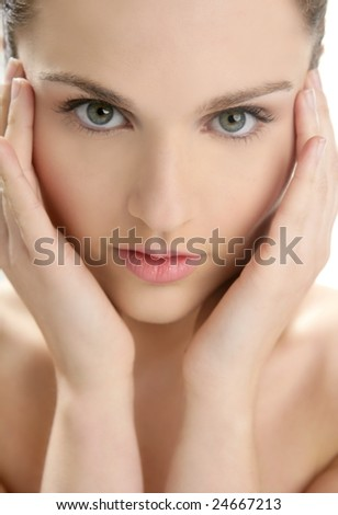Beautiful woman portrait with hands on head isolated on white at studio - stock photo