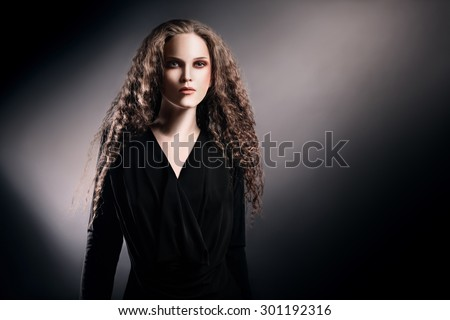 Beautiful woman portrait with long thick hair Curly model portrait