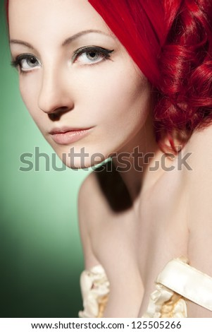 Beautiful woman portrait with red curly hair - stock photo