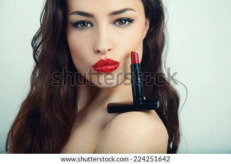 beautiful woman portrait with red lipstick on her shoulder, studio shot - stock photo