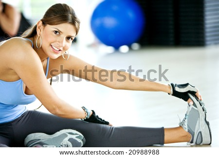 beautiful woman portrat at the gym smiling - stock photo