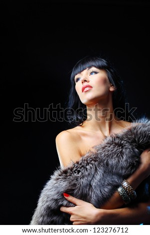 Beautiful woman posing at studio - stock photo