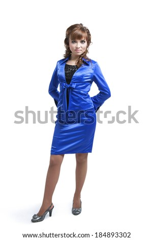 beautiful woman posing in a blue suit on a white background