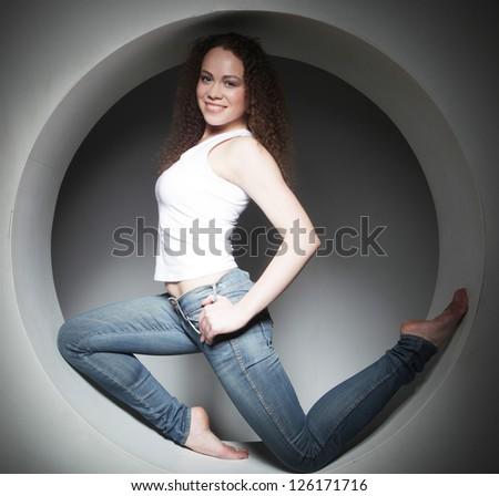 beautiful woman posing in circle - stock photo