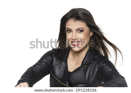 Beautiful woman posing leather jacket on white background