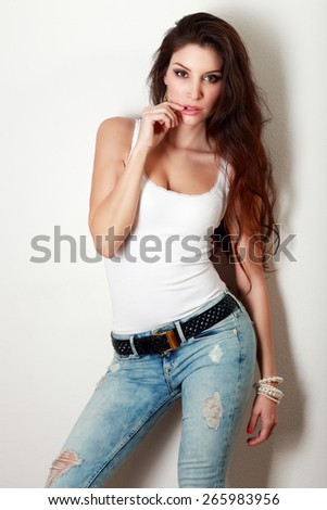 beautiful woman posing near wall fashion toning - stock photo