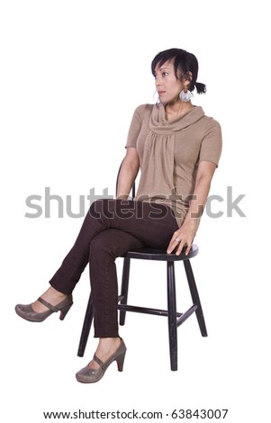 Beautiful Woman Posing on a Chair - Isolated White Background