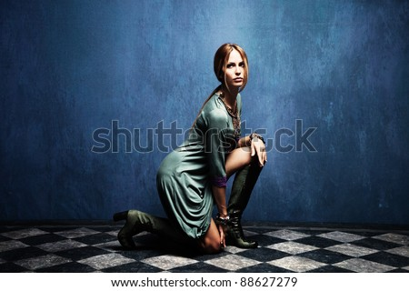 beautiful woman posing on floor,  full body shot, indoor shot - stock photo