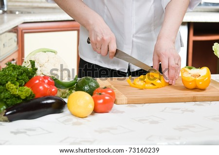 beautiful woman prepares food in the kitchen