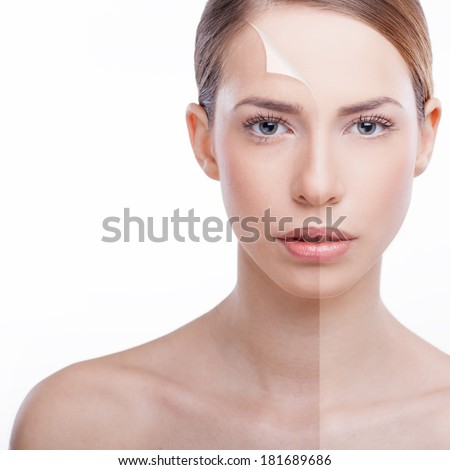 Beautiful woman presenting 'peeling back' anti-aging concept. Beauty treatment. - stock photo