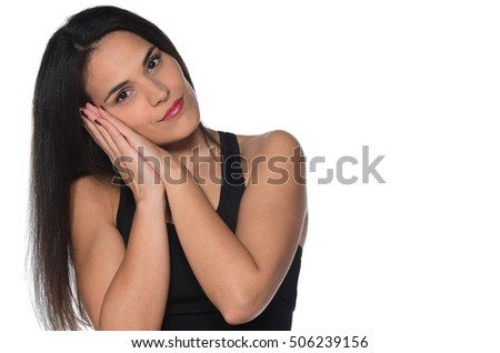 Beautiful woman pretending to sleep resting her head on her hands with her eyes open isolated on white