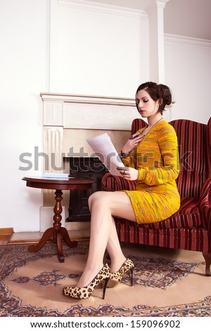 beautiful woman reading a love letter - stock photo