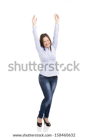Beautiful woman really happy with both arms on the air, isolated over white background - stock photo