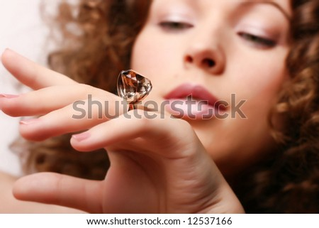 Beautiful woman receives a gift - stock photo