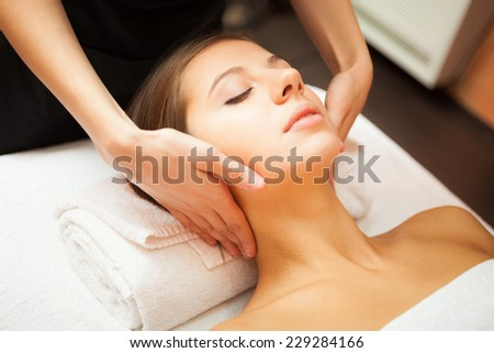 Beautiful woman receiving a massage - stock photo