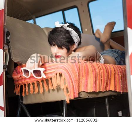 Beautiful woman relaxing in a car - stock photo