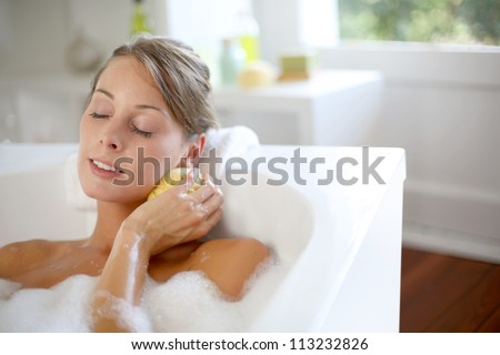 Beautiful woman relaxing in baththub