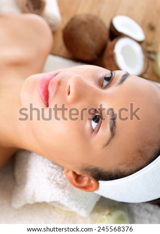 Beautiful woman relaxing in the beauty salon,. Figure of a woman in the office of the spa during surgery care.   - stock photo