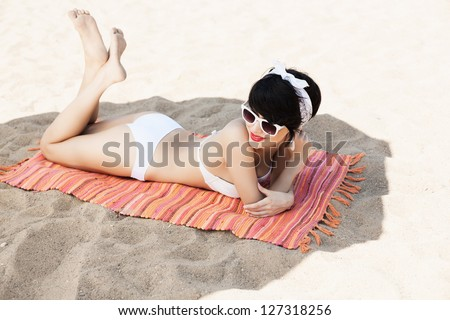 Beautiful woman relaxing on the beach - outdoors - stock photo