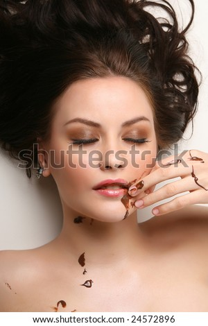beautiful woman relaxing with melted chocolate - stock photo