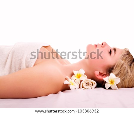 Beautiful woman resting in spa treatment after massage - stock photo