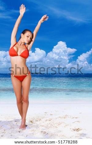 Beautiful woman resting on beach at Maldives - stock photo