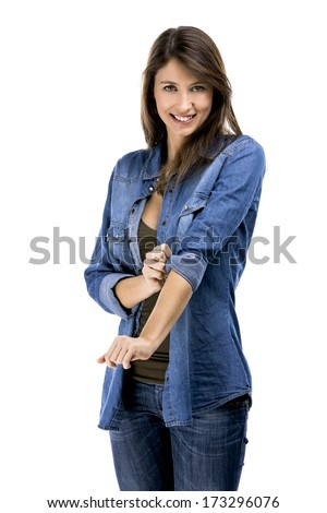 Beautiful woman rolling up her sleeves, isolated over white background - stock photo
