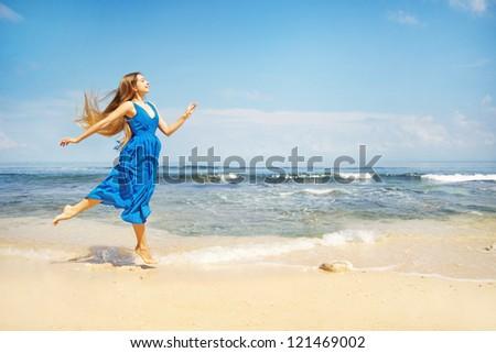 beautiful woman running on beach bali - stock photo