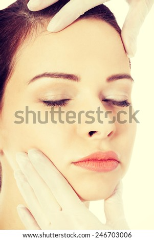 Beautiful woman's face is prepared to plastic surgery. - stock photo