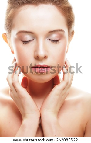 Beautiful woman's face with clean skin - isolated on white - stock photo
