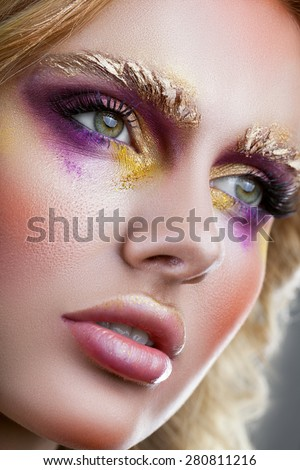Beautiful woman's face with gorgeous make-up close-up - stock photo