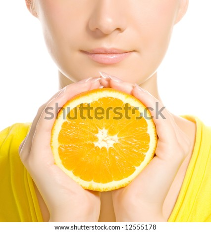 Beautiful woman's face with juicy orange - stock photo