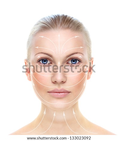 Beautiful woman's face with massage lines isolated on white. - stock photo