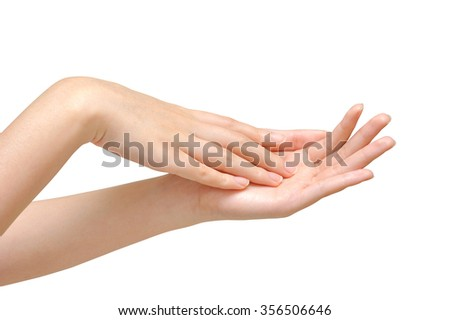 Beautiful woman's hands on the white background - stock photo