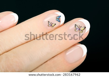 Beautiful woman's hands with french manicure on black background  - stock photo
