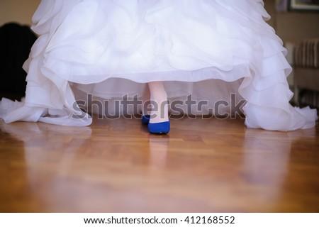 Beautiful woman's  long legs in white wedding dress - stock photo