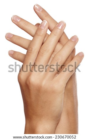 Beautiful woman's nails with perfect french manicure on white background. Care for female hands. - stock photo