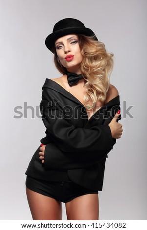 Beautiful woman sends kiss. Retro style. - stock photo