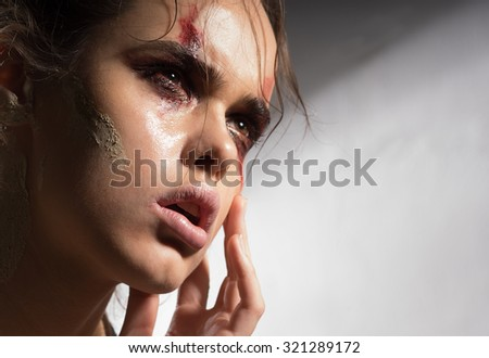 Beautiful woman severely beaten