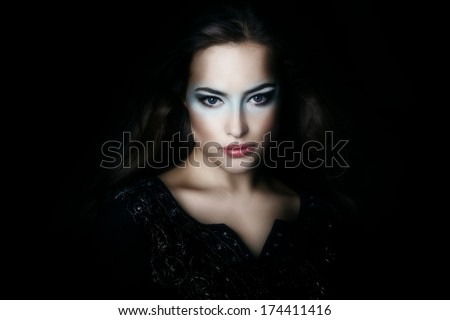 beautiful woman shine from the dark  studio shot - stock photo