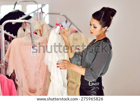 Beautiful woman shopping in the boutique - stock photo