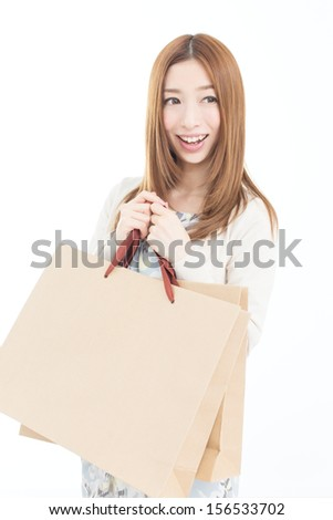 Beautiful woman shopping isolated on white background