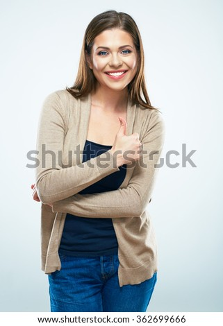 Beautiful woman show thumb up. Isolated portrait of toothy smiling female model with long hair. - stock photo