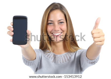 Beautiful woman showing a smart phone with thumb up isolated on a white background          - stock photo