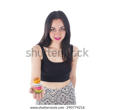 Beautiful woman showing different macaroons against a white background - stock photo
