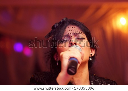 Beautiful woman sings at event